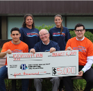 Event organizers present a $5,000 gift to the DRDH