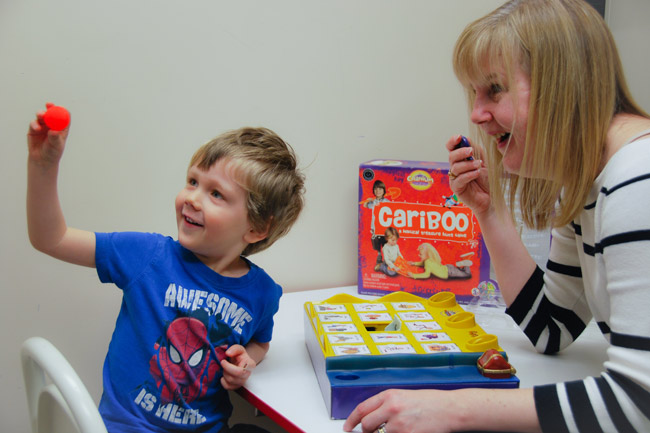 Young boy with speech language therapist